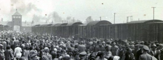 Photo Credit: AFP/ Yad Vashem Archives. A photo taken 27 May 1944 in Oswiecim, showing Nazis selecting prisoners on the platform at the entrance of the Auschwitz-Birkenau extermination camp.