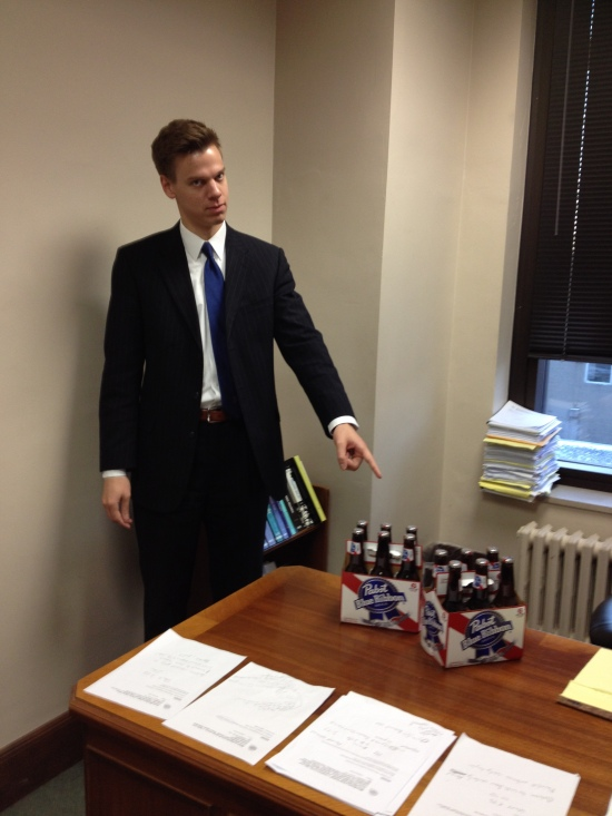 The good Matt points to the bad Matt's stash in the bad Matt's office at the federal courthouse