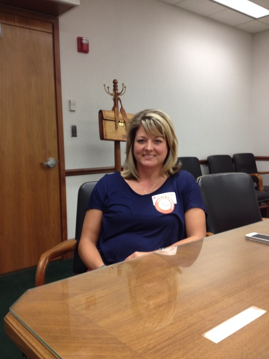 Jen, United States Probation Officer  (July 29, 2014). She is wearing a paper badge for a blood drive that she helped coordinate. The feds have gotten cheap, but Jen's official credentials are not yet made of paper.