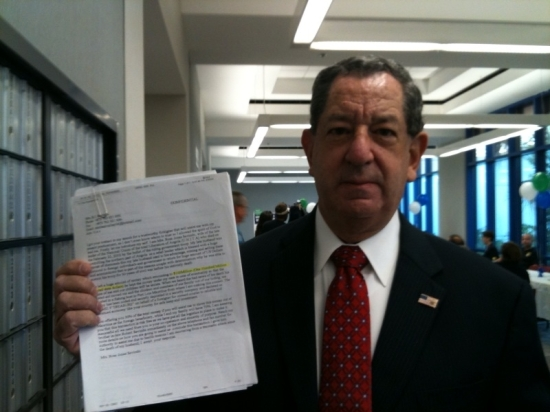 Photo credit: SunSentinel. Jeff holding up scam solicitation.