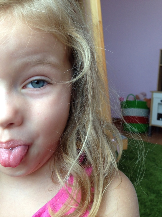 "Petra (who just turned 5) snagged her Mom's cell phone and took a selfie following ""Stinky Feet"" Grampa's example."