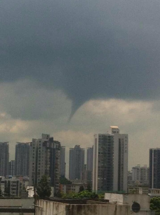 This photo was taken from Lisa and Karel's 16th floor apartment in Shekou.  It shows a very unusual weather event.  A typhoon and a tornado.  Schools were closed. By the way, if it looks like there are trees on the building in the forefront of the photo that is because there are trees on top of that building.