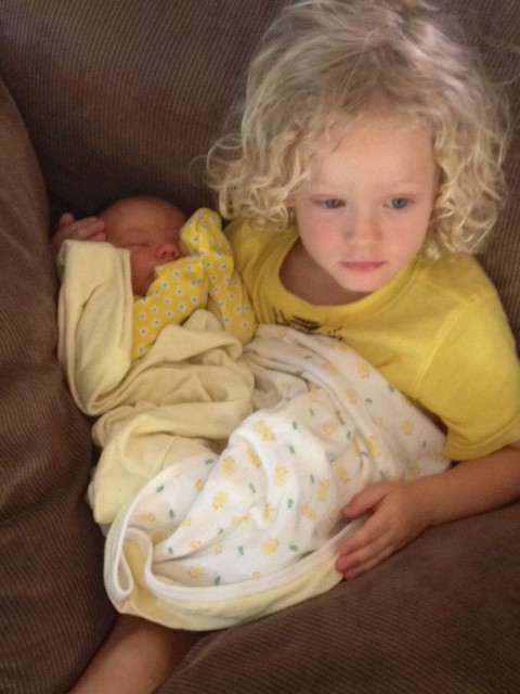 Fletcher loves to hold Indi! I wonder what he is thinking.