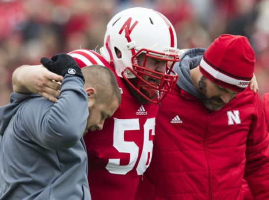 Photo credit: MATT RYERSON/Lincoln Journal Star Nebraska offensive lineman Mark Pelini (56) grimaces as he his helped off the field in the first quarter at Memorial Stadium on Saturday, Nov. 22, 2014.