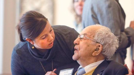 Photo credit: David Samson The Forum. Myron Bright receives well wishes from his granddaughter Amy Long of Fargo on Sunday during his 95th birthday celebration.