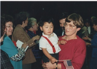Here is a photo of a dear, dear friend and former law clerk (Mary) and her little boy. Long ago, I had the privilege of conducting that naturalization ceremony when he became a citizen. He is all grown up now.