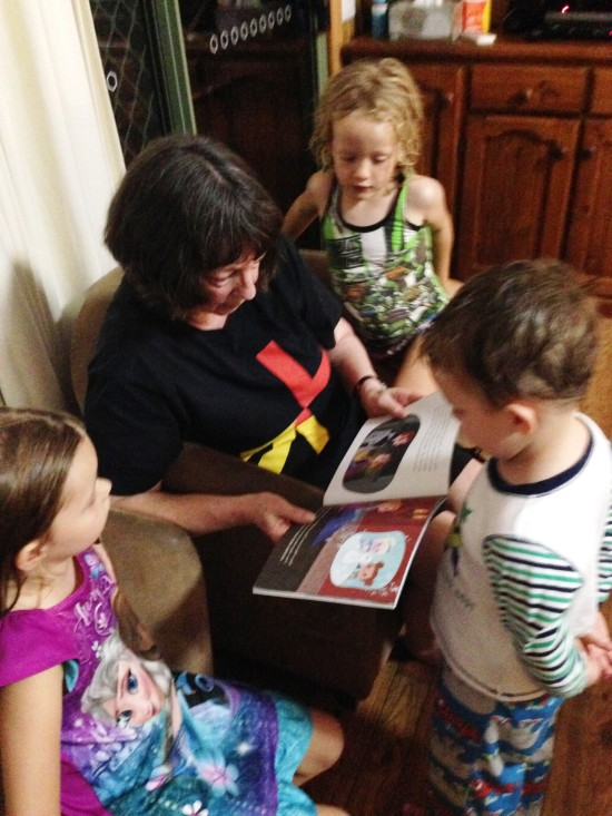 Gramma does her favorite thing in the whole  world, that is, read to grand children. Fletcher, Milan and Petra look on.
