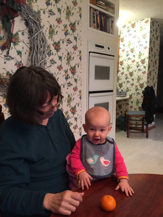 Gramma and Zora debate the taste of a Mandarin orange.