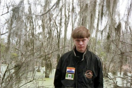 Photo credit: New York Times. The photo captures Dylann Storm Roof wearing a jacket with the flags of apartheid-era South Africa, top, and Rhodesia, as modern-day Zimbabwe was called during a period of white rule.